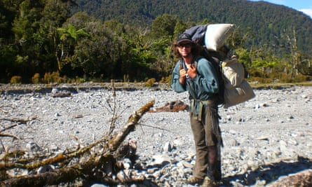 Chris Long with a backpack loaded with 40kg of possum fur and skin after a hunt.
