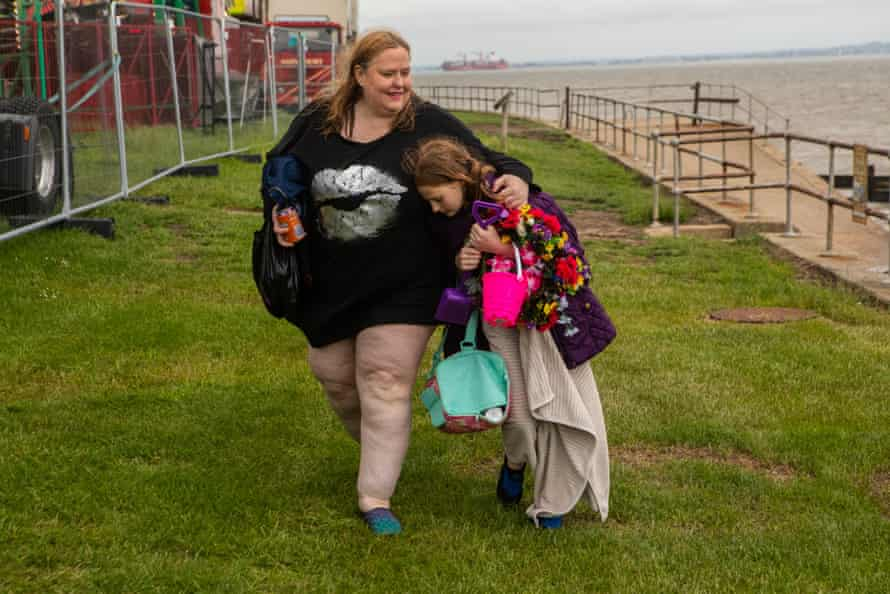 Anna Morell and her daugher leave All Hallows beach.
