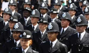 Newly qualified Metropolitan police officers take part in their Passing out Parade at Hendon police training college.