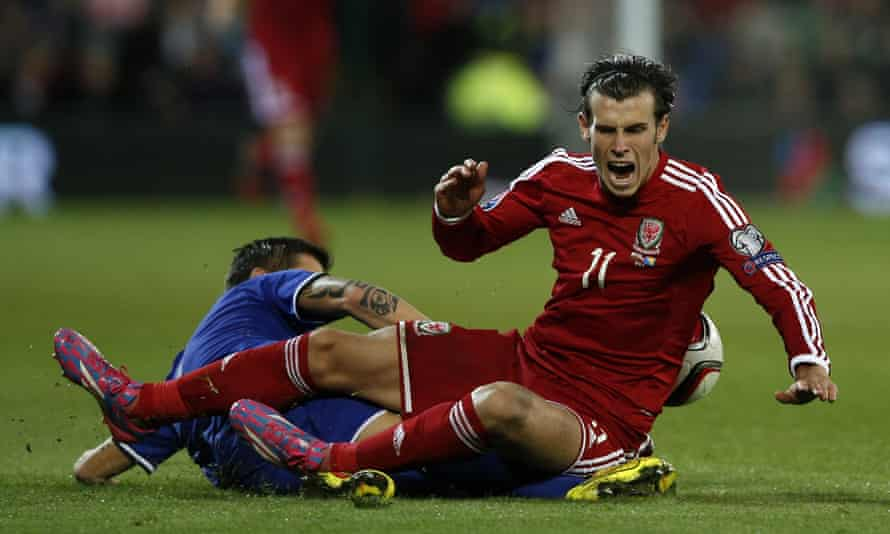 Wales' Gareth Bale feels the full force of a tackle from Bosnia and Herzegovina midfielder Muhamed Besic during the 0-0 Euro 2016 qualifier draw in Cardiff in October 2014