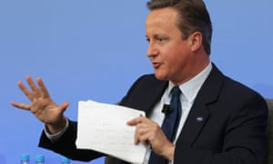 British Prime Minister David Cameron gestures as he participates in a panel discussion during the Anti-Corruption Summit London