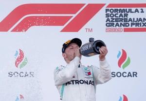 Bottas celebrates on the podium.