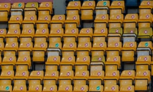 An area of seats is marked up with ticks and crosses at Carrow Road to indicate where the substitutes are permitted to sit.
