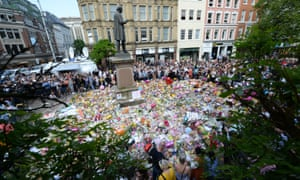 Floral tributes at a minute's silence in St Ann's Square, Manchester, to remember the victims of the terror attack at the Manchester Arena.