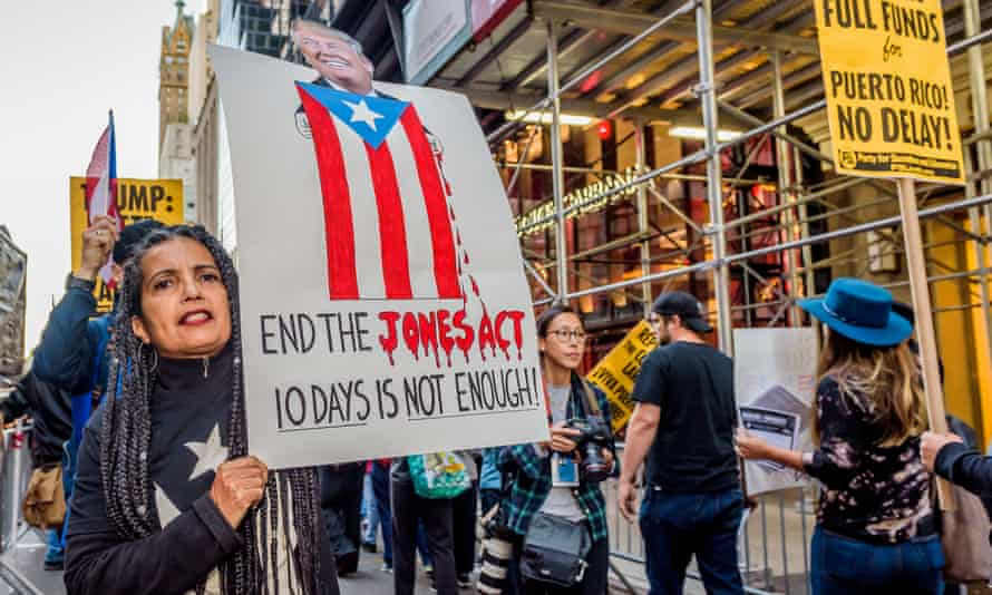 A protester at a 2 October rally in front of Trump Tower in Manhattan calls for the waiver of the Jones Act to be extended. The waiver expired Sunday and will not be renewed, DHS confirmed.