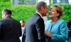 German Chancellor Angela Merkel welcomes President of the European Council Donald Tusk on June 29, 2017 at the Chancellery in Berlin ahead of a meeting with European G20 heads of state