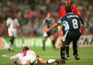 Diego Simeone reacts theatrically after David Beckham lashes out from the floor in the World Cup quarter-final between England and Argentina in 1998. Beckham was sent off.