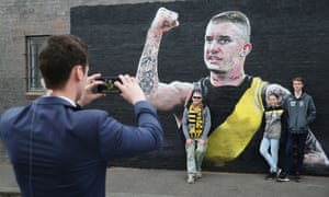 Fans pose with a Dustin Martin mural