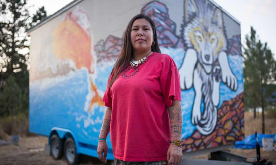 Secwepemc activist Kanahus Manuel in front of a tiny house being built in path of Kinder Morgan pipeline's planned route through her Nation's territory in British Columbia, Canada.