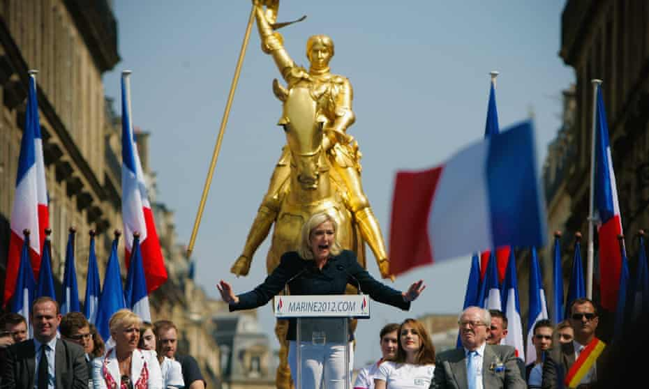 Marine Le Pen delivers a speech at the Front National's annual celebration of Joan of Arc in Paris.