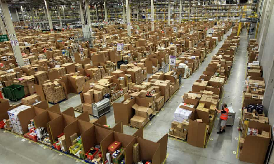 A worker collects items for delivery at Amazon's Swansea warehouse