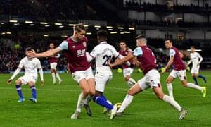 Chelsea's Callum Hudson-Odoi goes to ground as he tries to go past Burnley's Matthew Lowton and James Tarkowski (left).