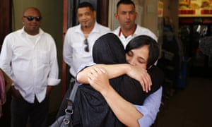 Celeste Nurse, right, the biological mother of the kidnapped child, embraces a family member