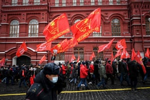 Russian Communist party supporters walk towards the mausoleum of the Russian communist revolutionary.