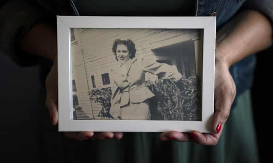 Stacy Cordova, whose aunt was a victim of California's forced sterilization program that began in 1909, holds a framed photo of her aunt Mary Franco, who was sterilised in the 1930s.