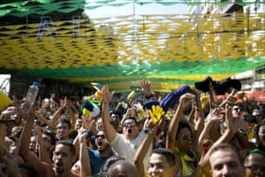 Brazil soccer fans celebrate their team's second goal against Mexico as they watch a live broadcast of the Russia World Cup match in Rio de Janeiro.