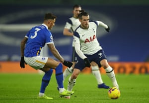 Gareth Bale of Tottenham Hotspur is closed down by Ben White of Brighton.