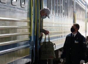 A passenger leaves a train in Kiev.