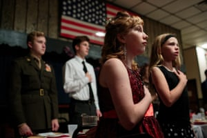 Young Marines attend a ball with their families and fellow students at their local VFW, 21 Oct 2017, Hanover, PA.Young Marines Ball:Tonight, every student is dressed in his or her finest dress or tuxedo. Young children are transformed into miniature adults, hair is pinned with fresh flowers, earrings shine in the neon light of the VFW, and the smell of cologne mixes with the meat and potato dinner on every dinner plate. Eyes are fixed on a large American flag as the National Anthem begins to fall from the lips of every individual present. Young Marines Ball, Hanover, Pennsylvania.