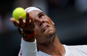 Rafael Nadal of Spain serves during his victory on Centre Court during day four of the 2018 Wimbledon tennis championships.