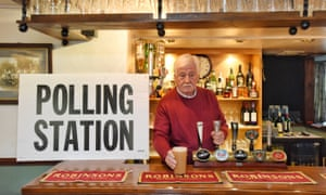 Pub landlord Ray Seavers pulls pints in The Bush Inn in the small Cumbrian village of Tallentire which is being used as a polling station