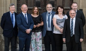 Sinn Féin's new cohort of seven MPs pose for a picture at the Palace of Westminster