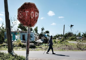 A man walks through a damaged neighborhood in the Caribbean island of Barbuda, which was nearly leveled by Hurricane Irma.