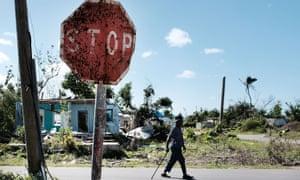 A man walks in Cordington, Barbuda, after Hurricane Irma hit the island in 2017.
