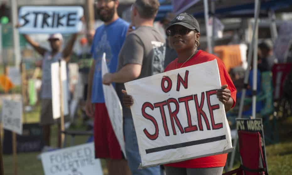 Kym Lewis, a Frito-Lay employee, stands on the strike line Thursday, July 22, 2021 outside of the Topeka plant. Workers said the main points of contention are small pay increases and employees being forced to work hours of overtime. (Evert Nelson /The Topeka Capital-Journal via AP)