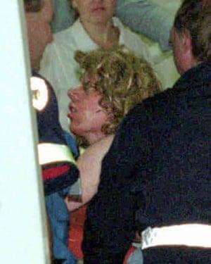 Gunman Martin Bryant is taken from an ambulance into Royal Hobart hospital