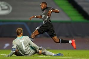 Goalkeeper Manuel Neuer denies Lyon's Karl Toko Ekambi.