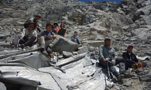 A group of Chilean mountaineers pose for a photo at the wreckage of a plane that crashed in the Andes 54 years ago, killing 24 people, including eight members of a professional soccer team.