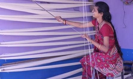 Nice new khadi: a woman prepares the cotton.