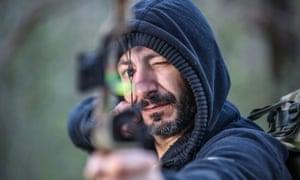 Survivalist Nick Sais with a bow and arrow
