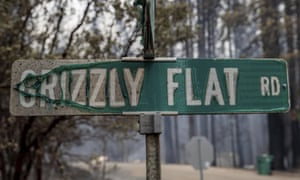 A partially melted street sign on Grizzly Flat Road.