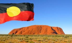 Aboriginal flag over Uluru