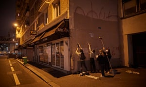 Activists known as Les Colleuses paste anti-femicide posters on a wall in Paris in October last year.