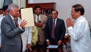 Sri Lankan president Maithreepala Sirisena gives a traditional greeting to re-appointed Prime Minister Ranil Wickramasinghe at the President Secretariat in Colombo, Sri Lanka.
