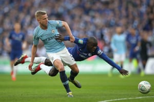 Kante goes to ground under pressure from Zinchenko.
