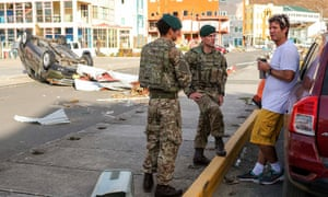 Royal Marines talking to a local resident in Road Town, Tortola, British Virgin Islands