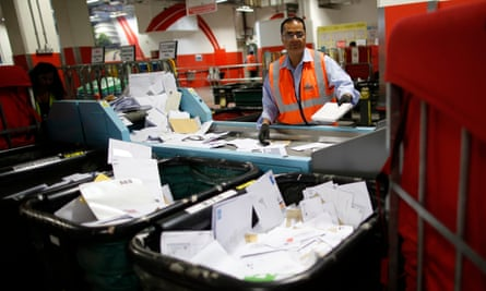 A postal worker at Mount Pleasant sorting office in London.