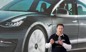 Elon Musk speaking at a delivery event in Shanghai, China, in January.