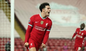 Curtis Jones of Liverpool celebrates after scoring the opening goal at Anfield.