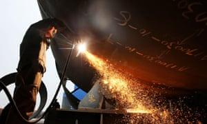 A worker welding steel at a shipyard in Nantong in China's eastern Jiangsu province.