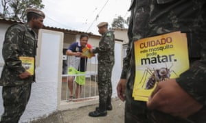 Brazilian soldiers distribute leaflets warning of the dangers of the Zika virus, January 2016