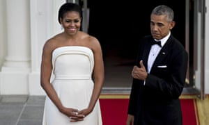 Michelle and Barack Obama, the latter perhaps wearing the same tux he owned for his eight years as president.