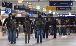 Special police commandos arrive at the main train station in Düsseldorf after axe attack
