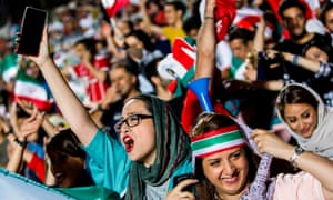 Fans cheer during a screening of the World Cup Group match between Iran and Spain in Tehran's Azadi stadium in June.
