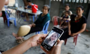 A relative looks at an image of Anna Bui Thi Nhung, one of the suspected Vietnamese victims.