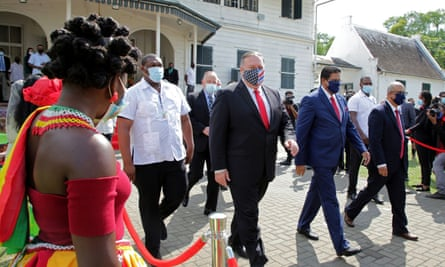 Mike Pompeo with Suriname's president Chan Santokhi in Paramaribo. Pompeo said: 'No state-owned operation can beat the quality of American private companies.'